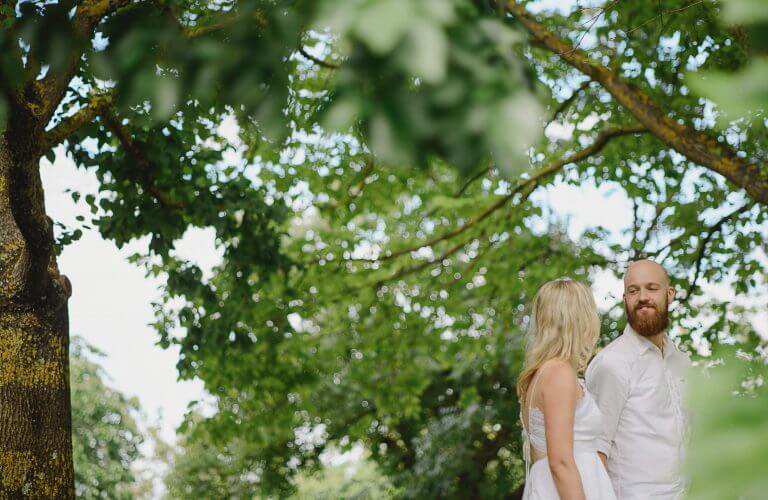 Emily & Brydon's lush green winery inspired couples portraits