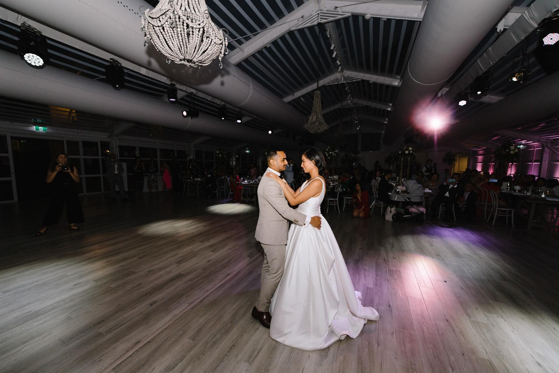 How do you photograph a dark wedding reception?